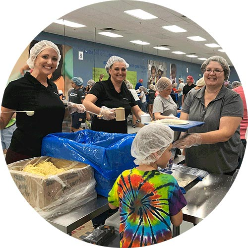 Stoker Ostler volunteers working at Feed My Starving Children