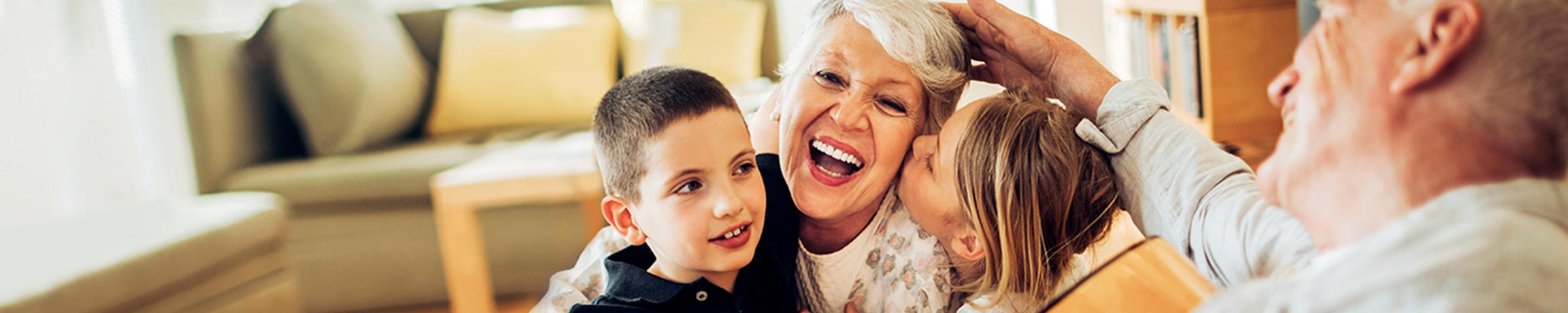Grandparents having fun at home with their grandchildren