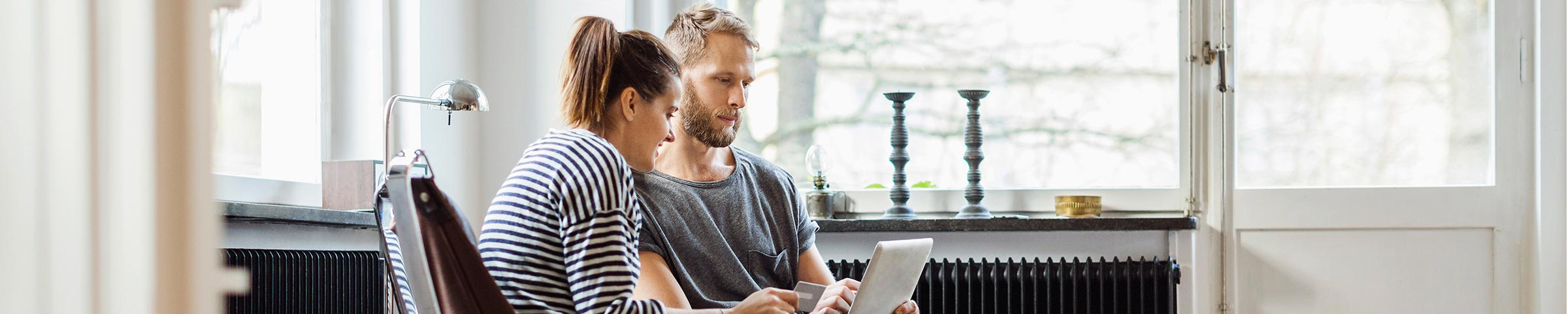 Couple reviewing their financial picture on their laptop