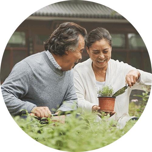 Couple gardening outdoors