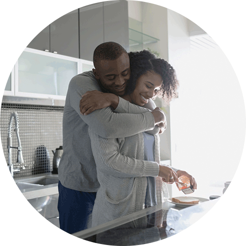 Man and woman in a renovated kitchen